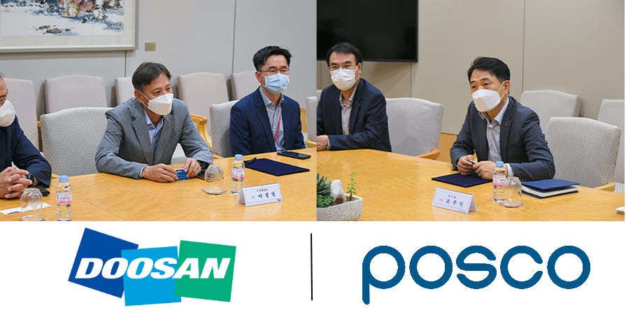The MoU signing ceremony, with Doosan and POSCO officials present.